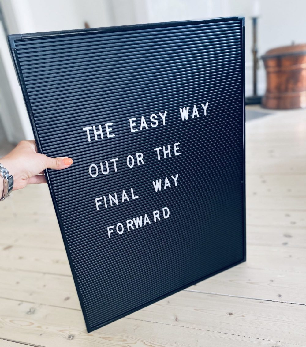 Sign with text the easy way out or the final way forward